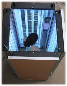 woman inside a foldalite phototherapy device