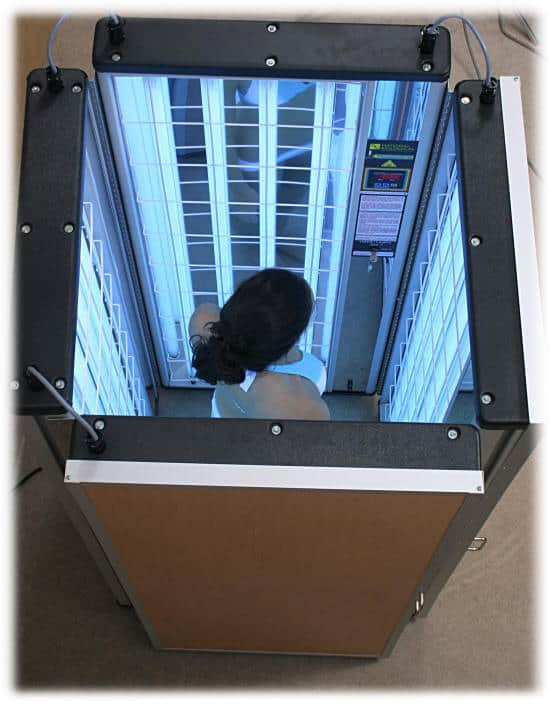 woman inside a foldalite phototherapy device