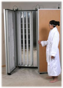 woman opening a foldalite phototherapy device